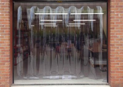 A roller shutter door combined with a strip curtain